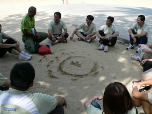 Debrief in the sand